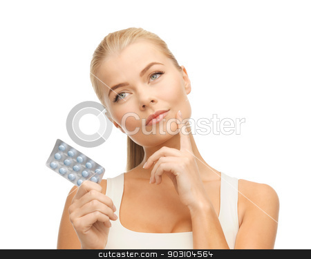 young woman with pills stock photo, picture of thoughtful young woman with pills by Syda Productions