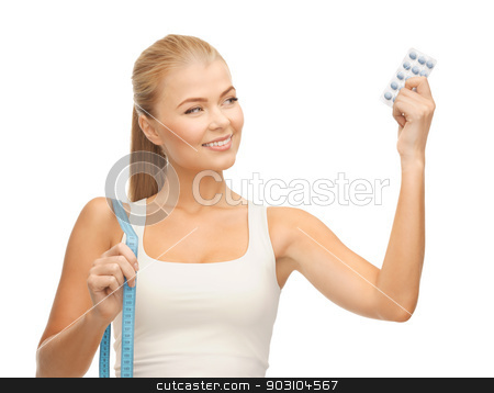woman with measuring tape and diet pills stock photo, sporty woman with measuring tape and diet pills by Syda Productions