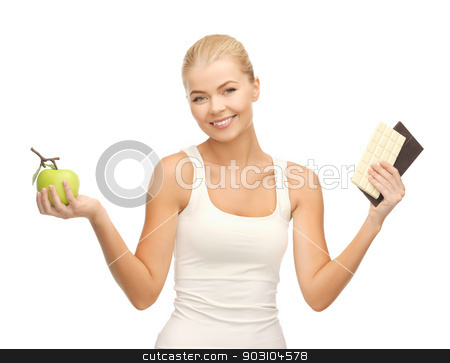 sporty woman with apple and chocolate bars stock photo, picture of sporty woman with apple and chocolate bars by Syda Productions
