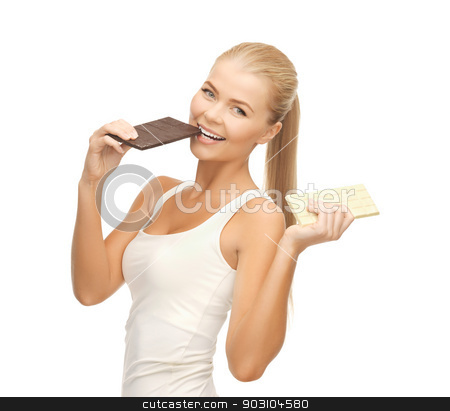 smiling woman with dark and white chocolates stock photo, picture of smiling woman with dark and white chocolates by Syda Productions