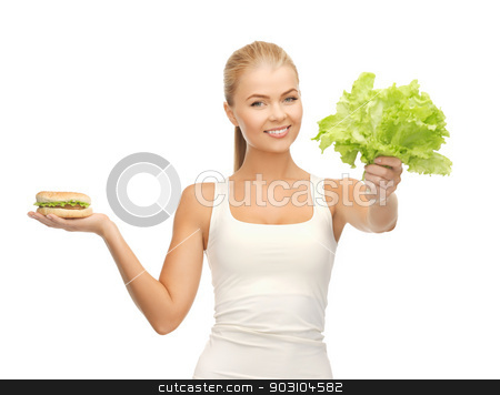 woman with green leaves and hamburger stock photo, picture of sporty woman with green leaves and hamburger by Syda Productions