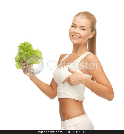 sporty woman with lettuce showing abs stock photo, picture of beautiful sporty woman with lettuce showing abs by Syda Productions