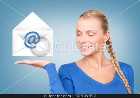 woman showing virtual envelope stock photo, picture of smiling woman showing virtual envelope by Syda Productions