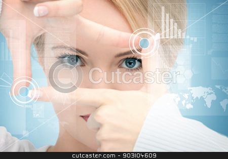 woman creating frame with fingers stock photo, woman creating frame with fingers and working with virtual screen by Syda Productions