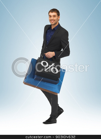 man with shopping bags stock photo, picture of handsome man with shopping bags by Syda Productions