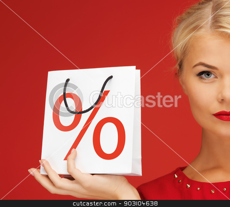 womaС' with shopping bag stock photo, picture of lovely woman in red dress with shopping bag by Syda Productions