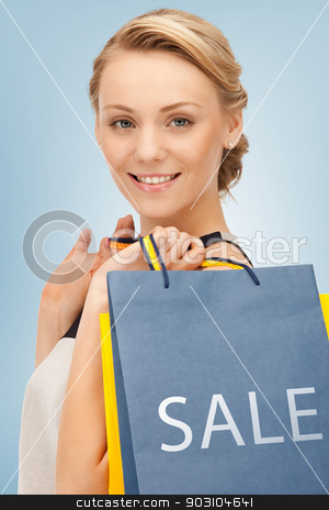 woman with shopping bags stock photo, picture of beautiful woman with shopping bags by Syda Productions