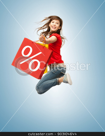 shopper stock photo, picture of jumping teenage girl with shopping bags by Syda Productions