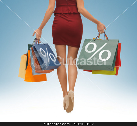 long legs with shopping bags stock photo, picture of woman's long legs with shopping bags by Syda Productions