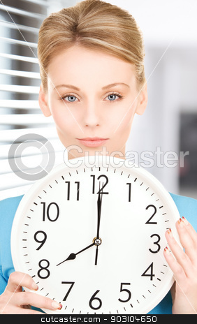 woman holding big clock stock photo, picture of woman holding big clock by Syda Productions