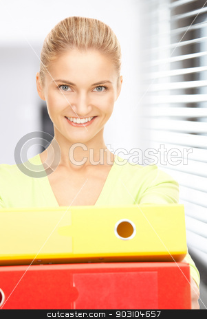 businesswoman with folders stock photo, picture of a young attractive businesswoman with folders by Syda Productions