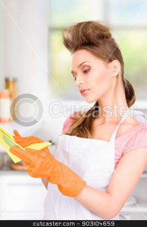 housewife washing dish stock photo, picture of beautiful housewife washing dish by Syda Productions