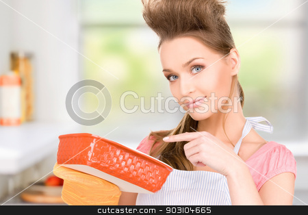 cooking housewife stock photo, picture of beautiful cooking housewife by Syda Productions