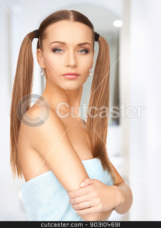 lovely woman in towel stock photo, bright picture of lovely woman in towel by Syda Productions