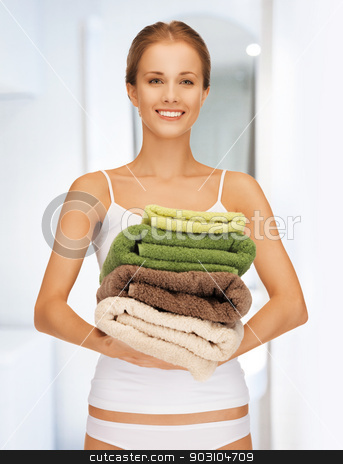lovely woman with towels stock photo, bright picture of lovely woman with towels by Syda Productions