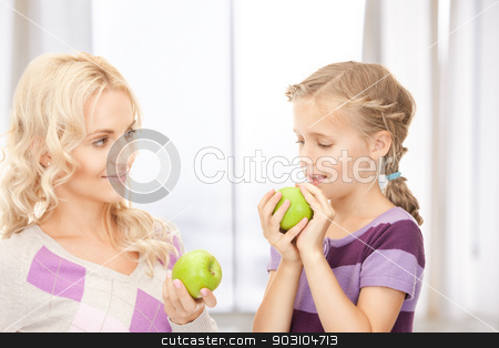 mother and little girl with green apple stock photo, picture of mother and little girl with green apple by Syda Productions