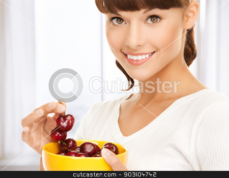healthy woman holding bowl with cherries stock photo, picture of healthy woman holding bowl with cherries by Syda Productions