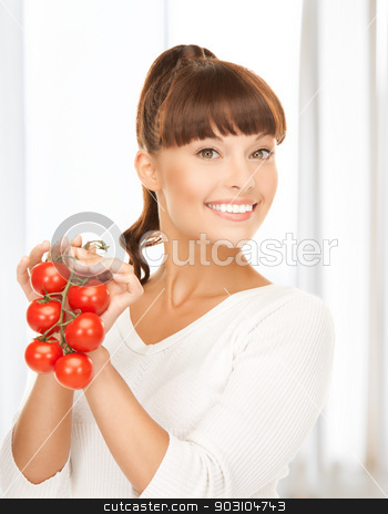 beautiful woman with shiny tomatoes stock photo, picture of beautiful woman with shiny tomatoes by Syda Productions