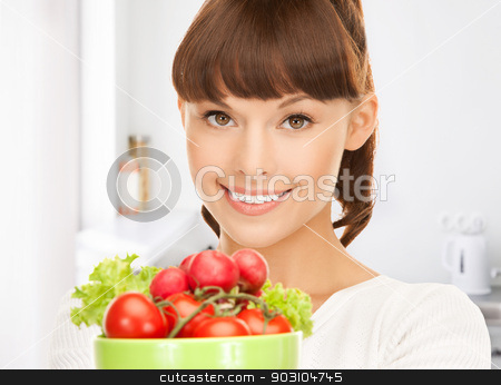 woman in the kitchen with tomatoes stock photo, beautiful woman in the kitchen with tomatoes by Syda Productions