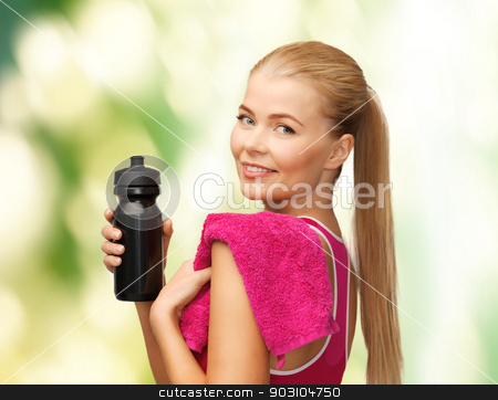 sporty woman with special sportsman bottle stock photo, picture of sporty woman with special sportsman bottle by Syda Productions