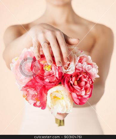bride with bouquet of flowers and wedding ring stock photo, close up of bride with bouquet of flowers and wedding ring by Syda Productions