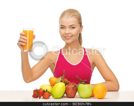 young woman with glass of orange juice stock photo, picture of young woman with glass of orange juice by Syda Productions