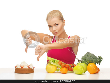 woman with fruits showing thumbs down to cake stock photo, woman with healthy food showing thumbs down to cake by Syda Productions