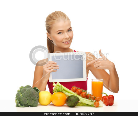 woman with fruits, vegetables and tablet pc stock photo, sporty woman with fruits and vegetables pointing at tablet pc by Syda Productions
