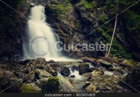 Waterfall stock photo, Mighty huge waterfall in the forest, horizontal by richpav