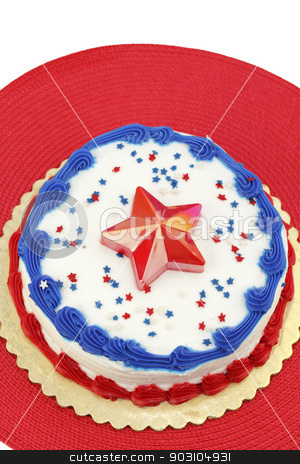 Independence Day Cake stock photo, Festive red, white and blue July 4th cake, decorated with edible star sprinkles, one large plastic star, and frosting. The dessert is placed on a gold foundation over a round red place mat.  by Lee Serenethos
