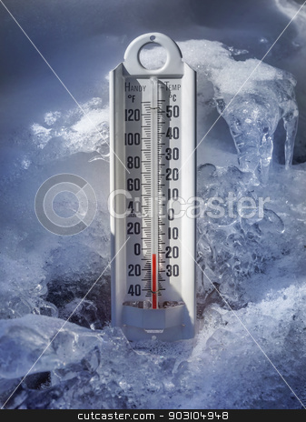 Freezing temperatures stock photo, Thermometer in ice and snow registering below zero by Christian Delbert