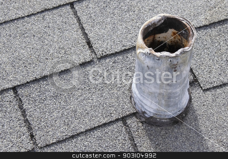 Roof Vent Stack that Needs Repair stock photo, Residential short gray metal roof vent stack and black boot that shows sign of wear on top and bottom from snaking out the plumbing pipe in the past and that needs repair so there is no water damage.  by Lee Serenethos