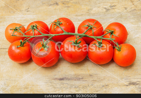 Cherry tomato isolated over a wooden background. stock photo, Cherry tomato isolated over the background, not in the kitchen. by SONGSAK  AROMYIM