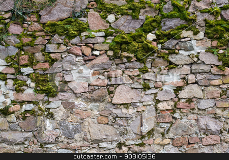 Old stone wall stock photo, Old stone wall with different size of rock and moss by Harry Huber