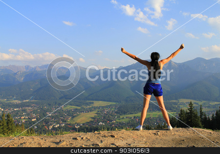 Young woman  standing on cliff's edge and looking to a sky  stock photo, Young woman  standing on cliff's edge and looking to a sky  by Jacky Brown