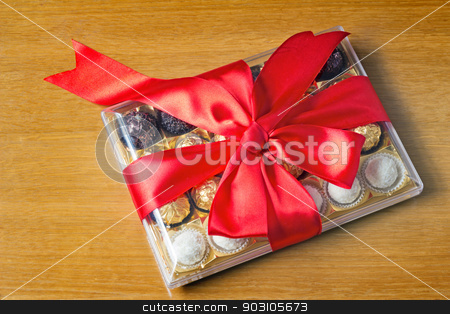 Gift for the holiday of New year, Christmas, Easter, birthday, a stock photo, A beautifully decorated and tied with a ribbon box of chocolates, gift by a holiday, celebration, anniversary. by Georgina198