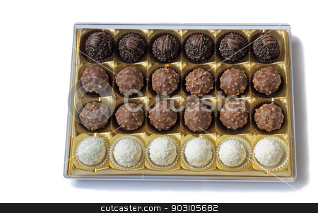 Chocolate sweets in the box on the white background. stock photo, Fragment of the open blue boxes of chocolates. Presented on a white background by Georgina198