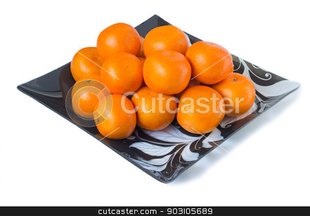 Large ripe tangerines in a glass dish on a white background. stock photo, Large ripe oranges are located on a dish made of dark glass with ornament. Presented on a white background by Georgina198