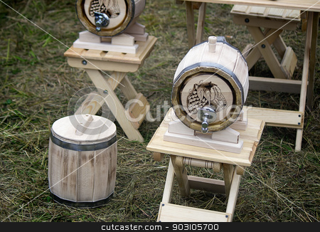 Wooden oak barrel wine, beer with metal crane. Sold at the fair. stock photo, Beautifully decorated with oak barrel with a metal crane, is located on a convenient wooden stand. by Georgina198