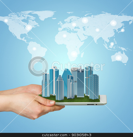 Hands holding tablet computer stock photo, Hands holding a tablet computer. In screen tablet city of skyscrapers by cherezoff