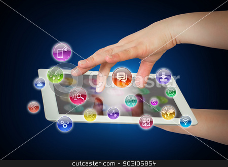 Hands holding tablet pc stock photo, Hands holding tablet pc and application icons. The concept of software by cherezoff
