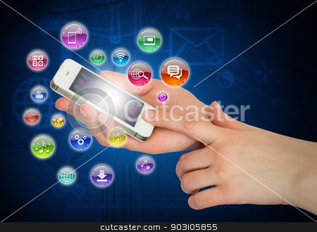 Hands holding smartphone stock photo, Hands holding smartphone and application icons. The concept of software by cherezoff