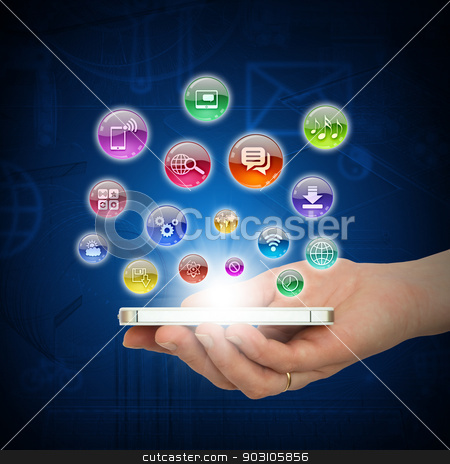 Hand holding smartphone stock photo, Hand holding smartphone and application icons. The concept of software by cherezoff