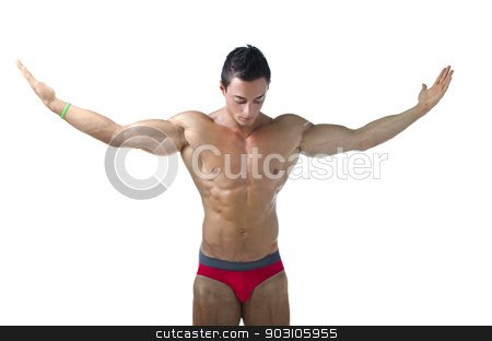 Muscular young bodybuilder looking down with arms spread open stock photo, Muscular young bodybuilder looking down with arms spread open. Isolated on white by Stefano Cavoretto