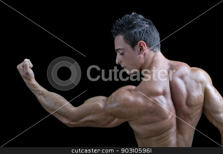 Muscular young bodybuilder's back. Looking at bicep stock photo, Muscular young bodybuilder seen from the back, looking at his own bicep. Isolated on black by Stefano Cavoretto