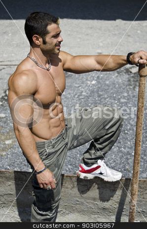 Muscular construction worker shirtless outdoors in building site stock photo, Muscle man shirtless outdoors in building site. Construction worker by Stefano Cavoretto