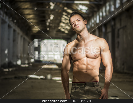 Muscular shirtless young man in abandoned warehouse standing stock photo, Muscular shirtless young man in abandoned warehouse standing, looking at camera by Stefano Cavoretto
