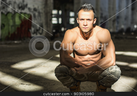 Muscular shirtless young man in abandoned warehouse sitting stock photo, Muscular shirtless young man in abandoned warehouse sitting, looking at camera by Stefano Cavoretto