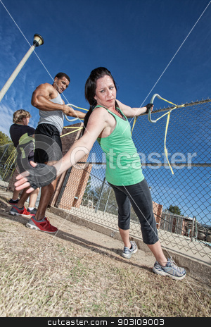 Resistance Bands Workout stock photo, Three adults using resistance bands in outdoor fitness class by Scott Griessel