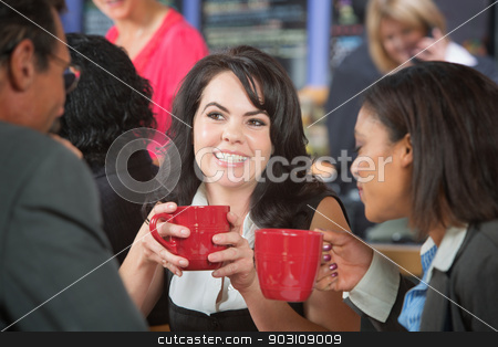 Grinning Woman with Coffee and Coworkers stock photo, Grinning woman and coworkers with coffee in bistro by Scott Griessel